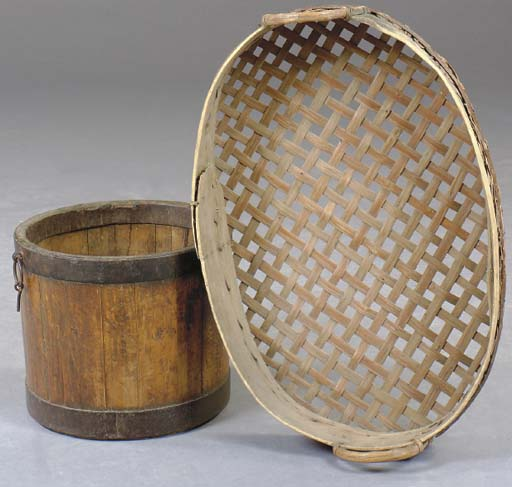 AN OVAL WOVEN BASKET TOGETHER
