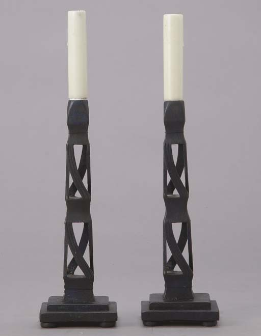 A PAIR OF EBONISED CARVED WOOD