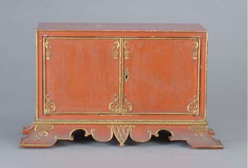 A RED-PAINTED AND PARCEL GILT