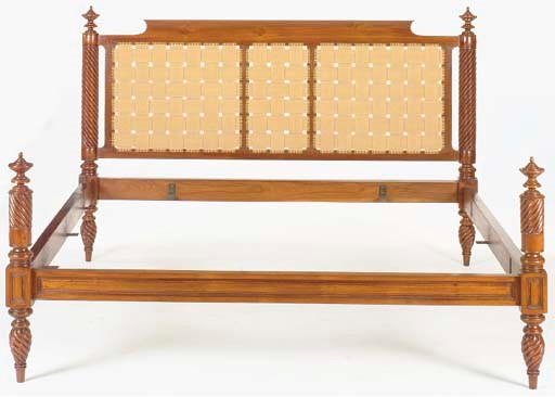 A CARVED TEAK AND CANVAS BED,