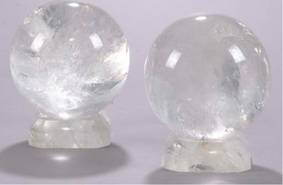 A PAIR OF ROCK CRYSTAL ORBS ON
