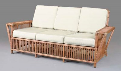 A RATTAN PATIO SETTEE WITH FOA
