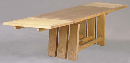 AN ARTS AND CRAFTS STYLE OAK D