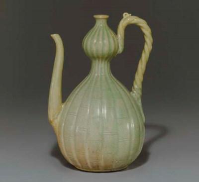 A Carved Celadon Ewer