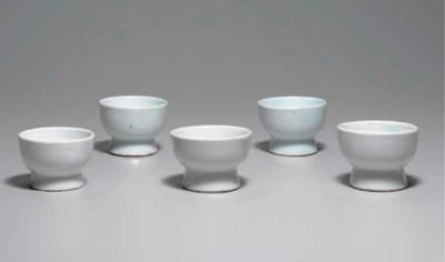 Five White Porcelain Cups
