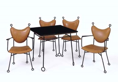 A Wrought-Iron Table with Four