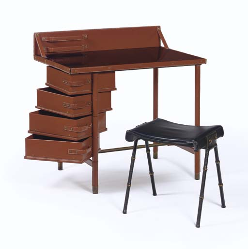 A Leather and Brass Desk and S