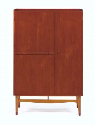A Walnut and Beech Cabinet, 19