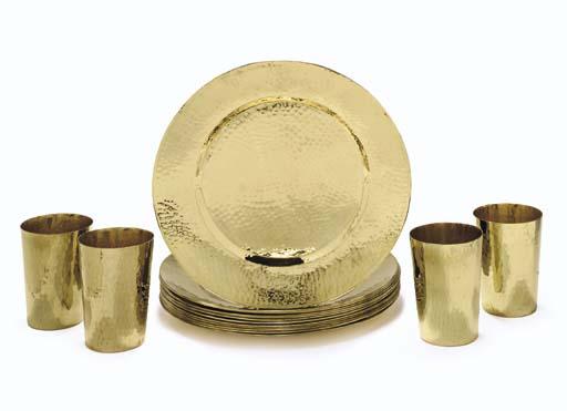 A Set of Twelve Hammered Brass