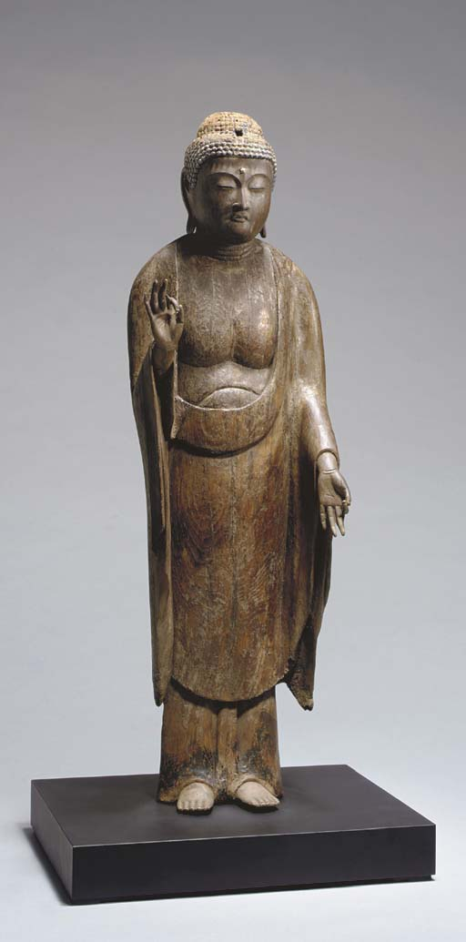A Wood Figure of Standing Amid