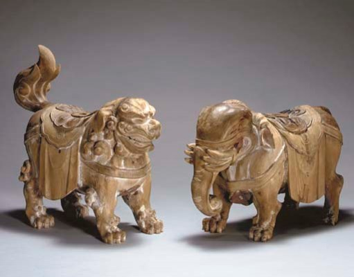 Two Wood Figures of Mounts for