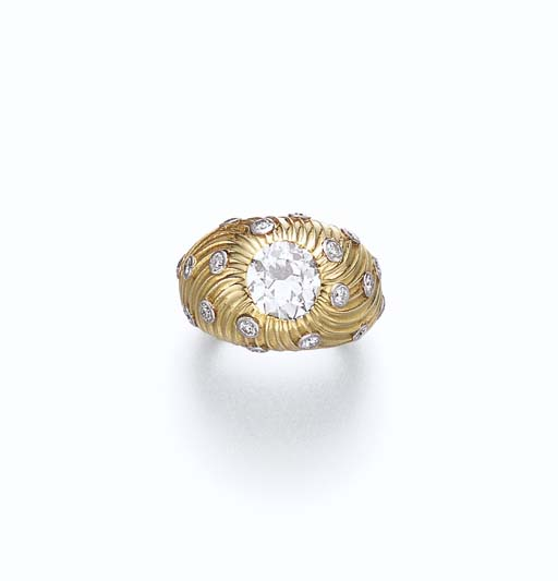 A DIAMOND AND GOLD RING, BY JE