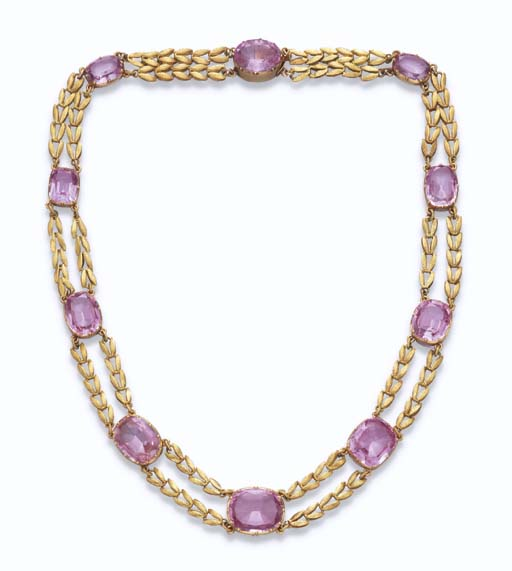 AN ANTIQUE PINK TOPAZ AND GOLD