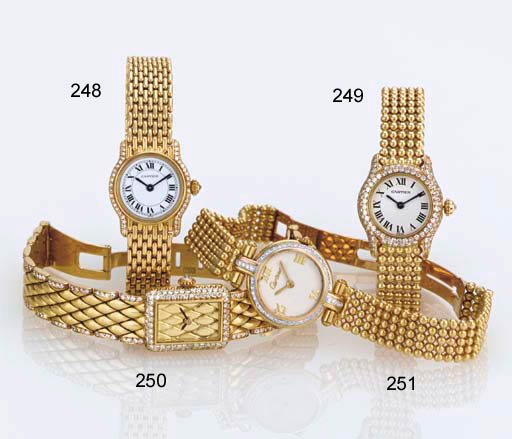 CARTIER. A LADY'S 18K TWO-COLO