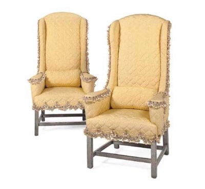 A PAIR OF SILVERED WING CHAIRS