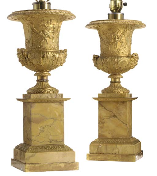 A PAIR OF RESTAURATION ORMOLU AND SIENA MARBLE URNS