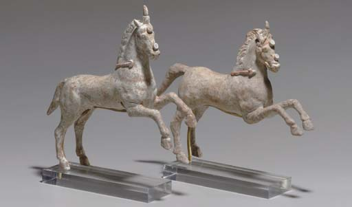 TWO GREEK TERRACOTTA HORSES