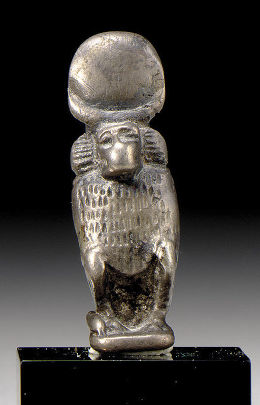 AN EGYPTIAN ELECTRUM BABOON AMULET