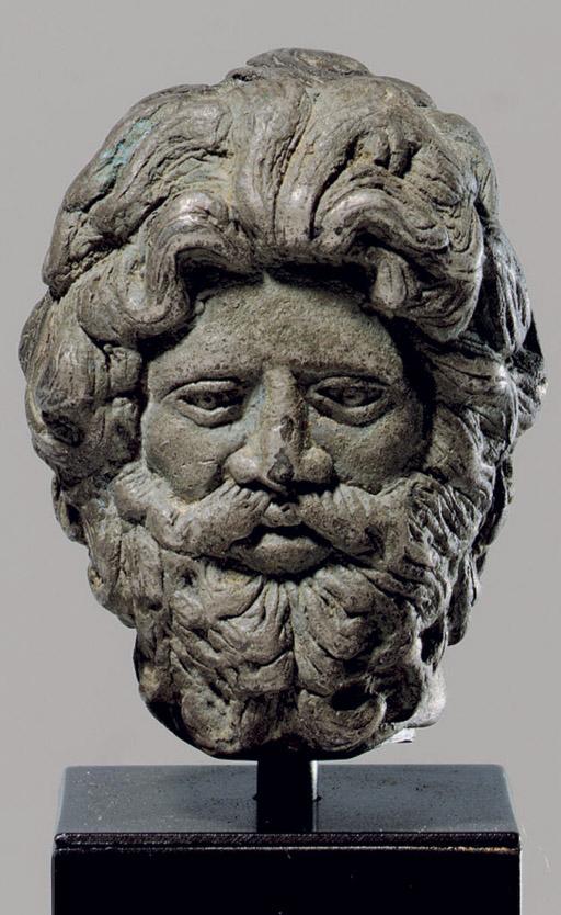 A ROMAN SILVER HEAD OF AN OLYMPIAN