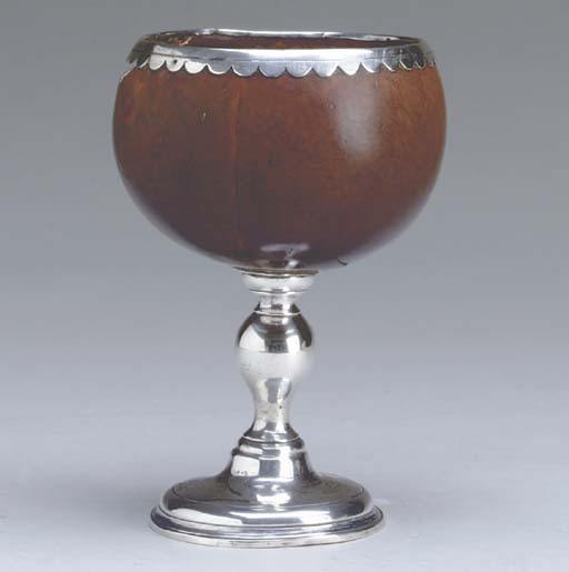 A SILVER-MOUNTED COCONUT CUP,