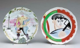 TWO PORCELAIN PLATES IN THE STYLE OF SOVIET PROPAGANDA,