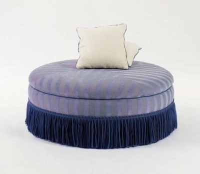 A CIRCULAR BLUE UPHOLSTERED PO