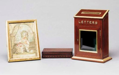 AN ENGLISH MAHOGANY LETTER BOX