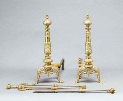 A PAIR OF BRASS ANDIRIONS TOGE