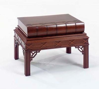 A MAHOGANY BOOK-FORM LOW TABLE