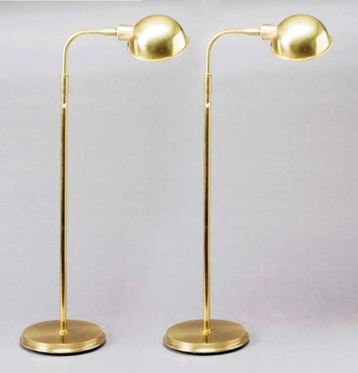 A PAIR OF BRASS ADJUSTABLE REA