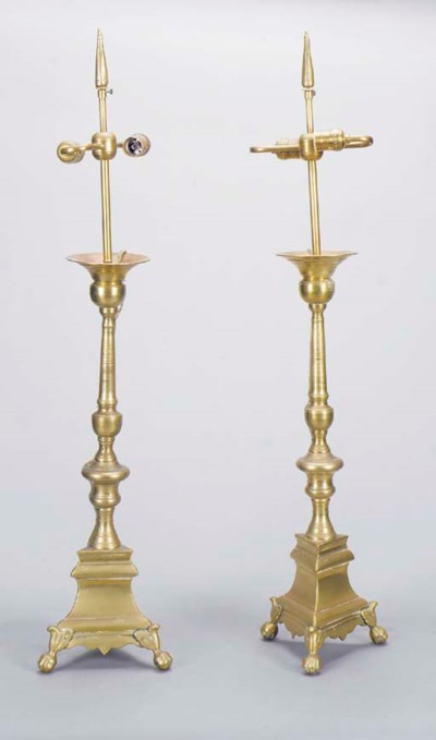A PAIR OF BRASS ALTER STICKS M