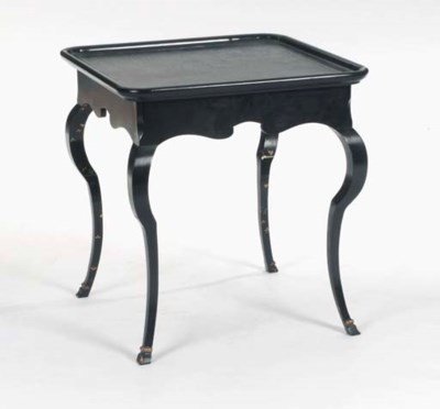 A PAIR OF EBONISED PARCEL- GIL