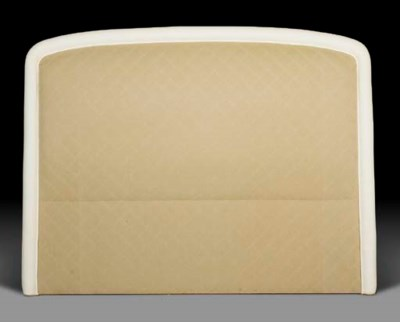 A KING SIZE CREAM UPHOLSTERED