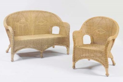 A PAIR OF NATURAL WICKER ARMCH