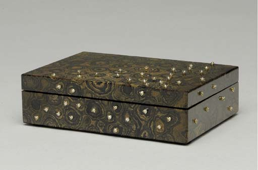 A MOTTLED BROWN BOX INSET WITH DIAMONDS,