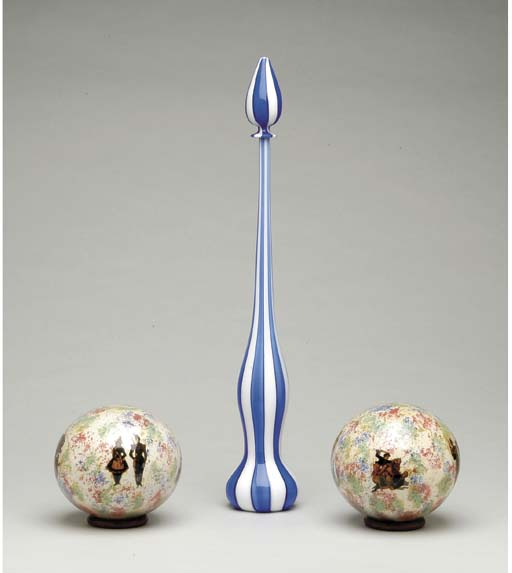 A PAIR OF BLOWN GLASS BALLS AND A DECORATIVE BLUE AND WHITE STRIPED GLASS VASE,