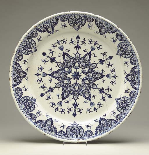 A CONTINENTAL BLUE AND WHITE FAIENCE CIRCULAR PLATTER,