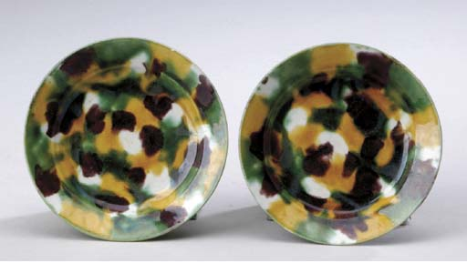 A PAIR OF SMALL AUBERGINE, GREEN AND YELLOW-GLAZED SAUCER DISHES,