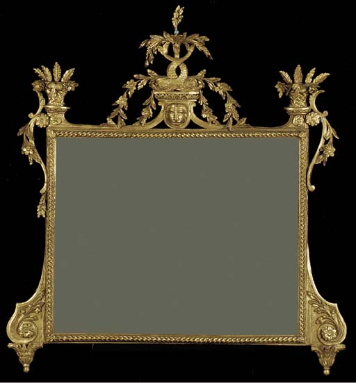 A GILTWOOD AND COMPOSITION OVERMANTLE MIRROR,
