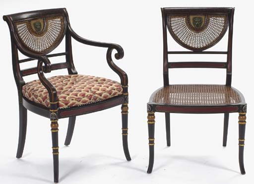 A SET OF EIGHT REGENCY STYLE EBONIZED AND POLYCHROME PAINT DECORATED CANED DINING CHAIRS,