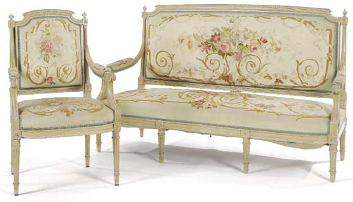A LOUIS XVI STYLE CREAM PAINTED AND GROS POINT UPHOLSTERED SALON SUITE,