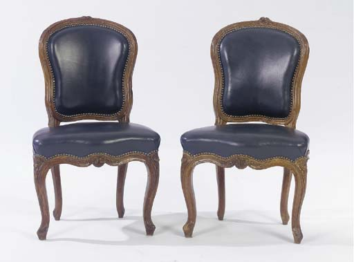 A SET OF FOUR LOUIS XV WALNUT SIDE CHAIRS,