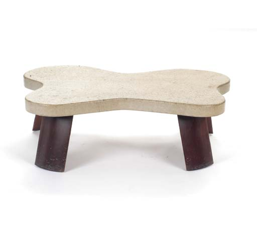 A LAMINATRED CORK AND WOOD LOW TABLE,