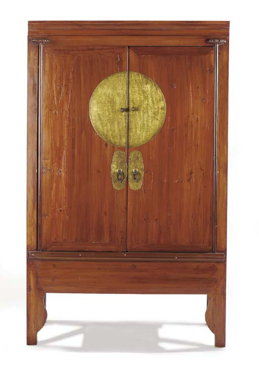 A SOUTHEAST ASIAN STAINED HARDWOOD AND BRASS MOUNTED CABINET,