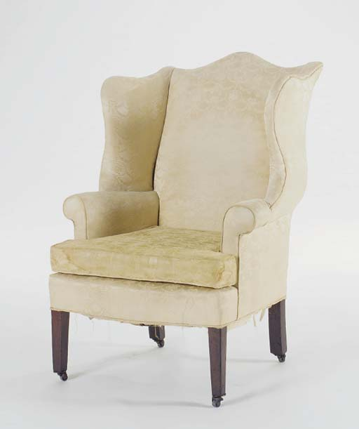 A YELLOW UPHOLSTERED MAHOGANY WINGBACK ARMCHAIR,