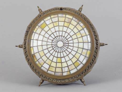 A PATINATED BRONZE AND LEADED GLASS CEILING FIXTURE,