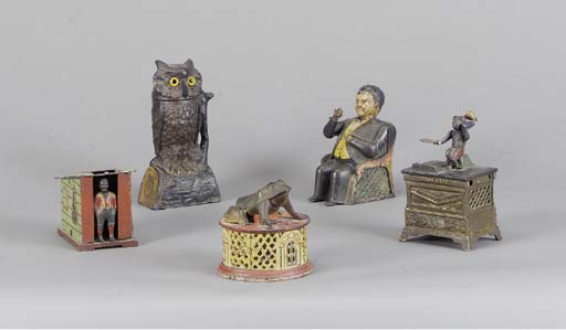 A GROUP OF FIVE PAINTED CAST IRON MECHANICAL MONEY BANKS,