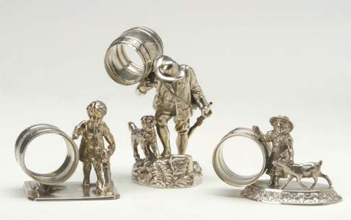 THREE AMERICAN SILVER-PLATED FIGURAL NAPKIN RINGS,