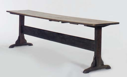 A CONTINENTAL STAINED-PINE REFECTORY TABLE