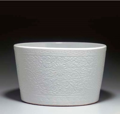 AN UNUSUAL WHITE-GLAZED CARVED